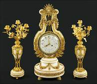 A French 19th Century Clock and Garniture Suite.
