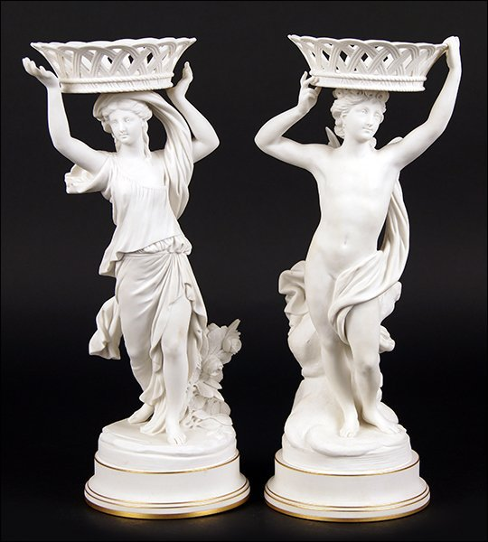 A Set of Two Sevres Bisque Porcelain Figural Compotes.