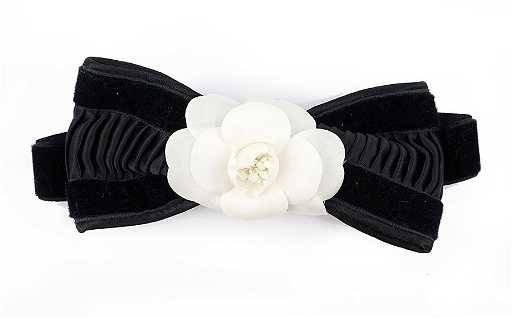 6b0d5a32e26810 A Chanel Black Velvet and White Camellia Blossom Bow. placeholder. See Sold  Price