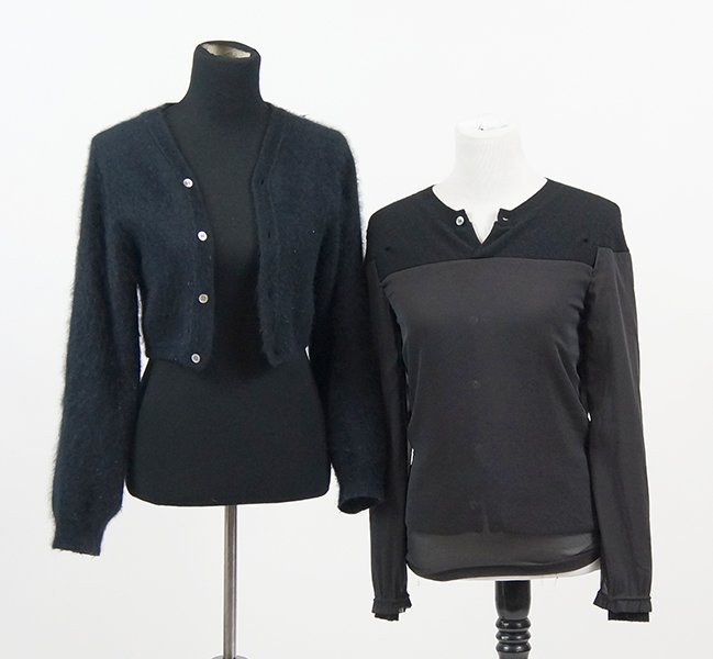 A Pair of Black Comme des Garcons Sweaters.