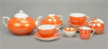 A German Iridescent Glazed Porcelain Child's Tea Set.