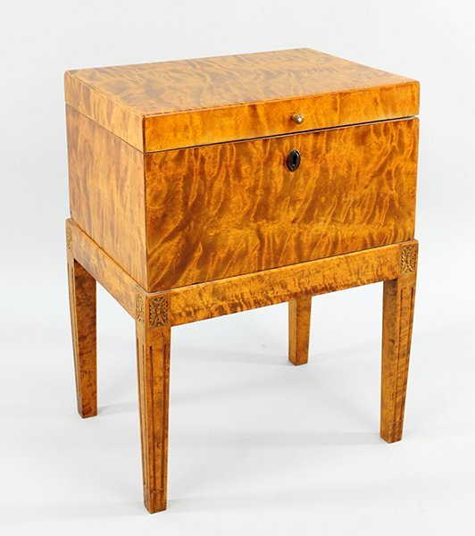 A Flame Birch Chest on Stand.