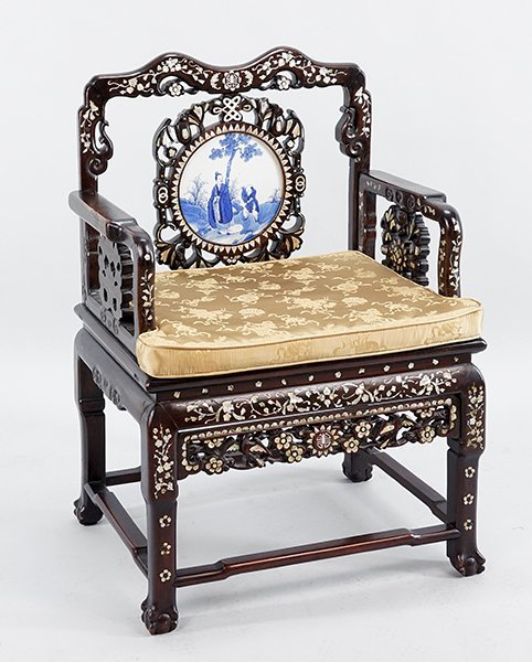 A Chinese Carved Rosewood Armchair.