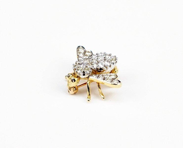A Diamond and 14 Karat Gold Bee Brooch.