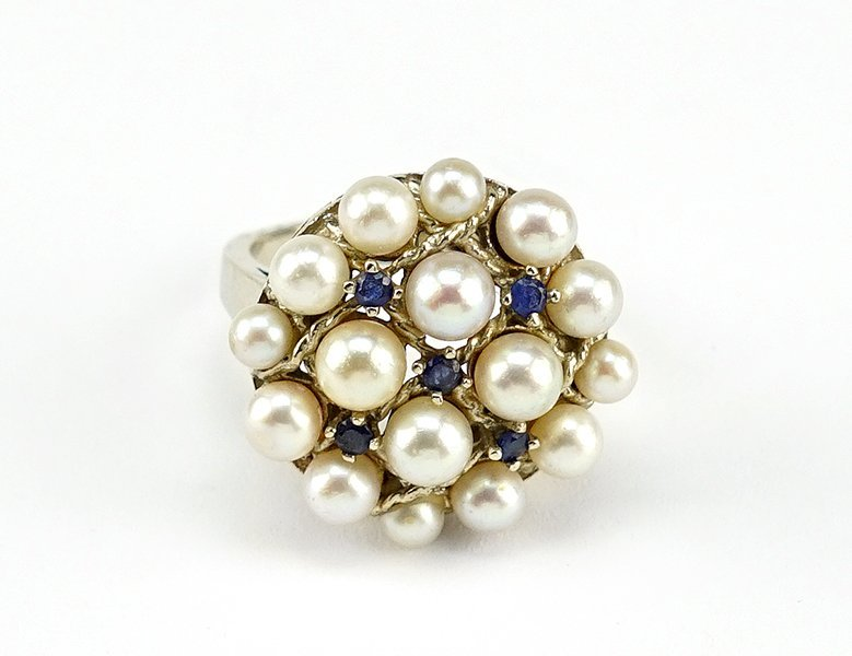 A Cultured Pearl and Sapphire Ring.