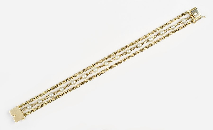 A Pearl and 14 Karat Yellow Gold Bracelet.