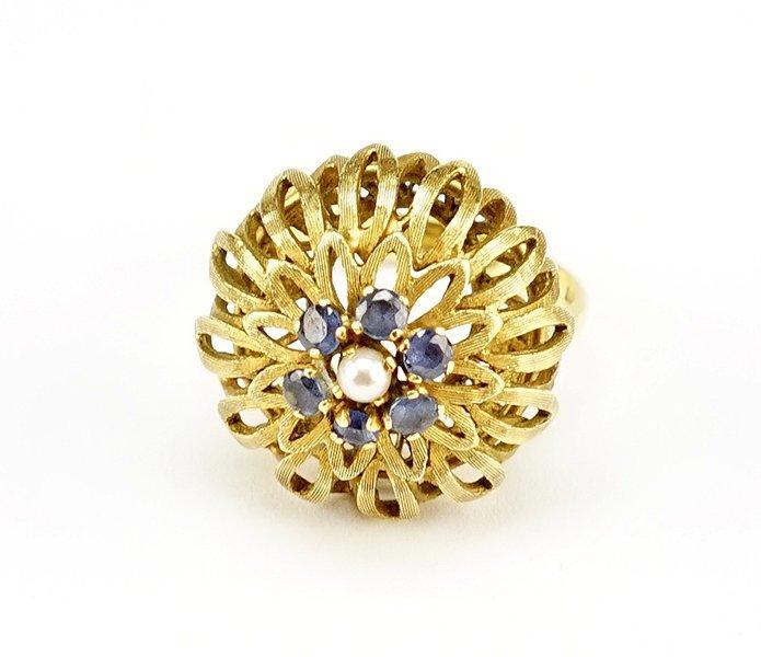 An 18 Karat Yellow Gold Cocktail Ring.