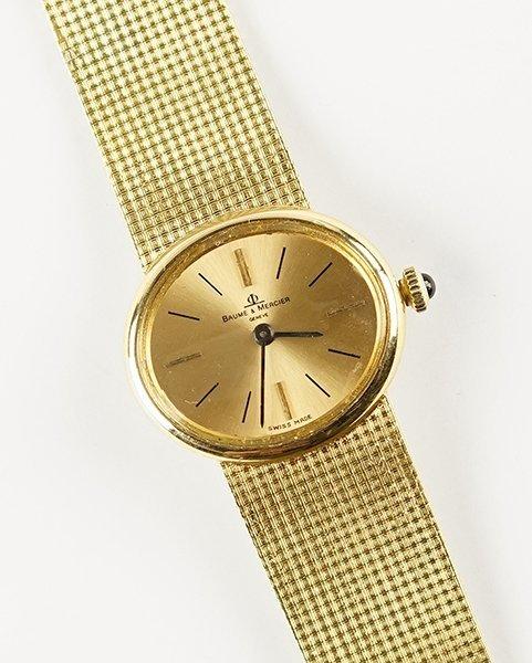 A Baume & Mercier 18 Karat Yellow Gold Watch.