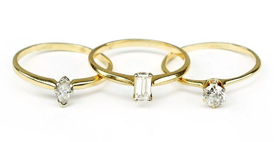Three Diamond and 14 Karat Yellow Gold Rings.
