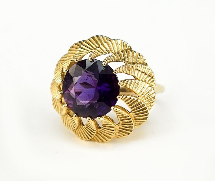 An Amethyst and 14 Karat Yellow Gold Cocktail Ring.