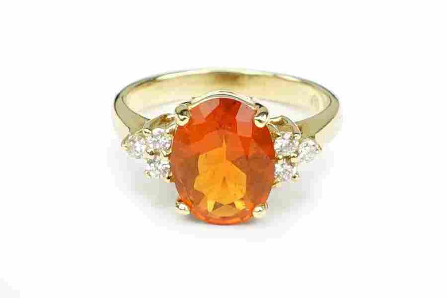 A Fire Opal and 14 Karat Yellow Gold Ring.