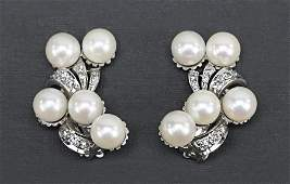 A Pair of Diamond and Pearl Earclips.