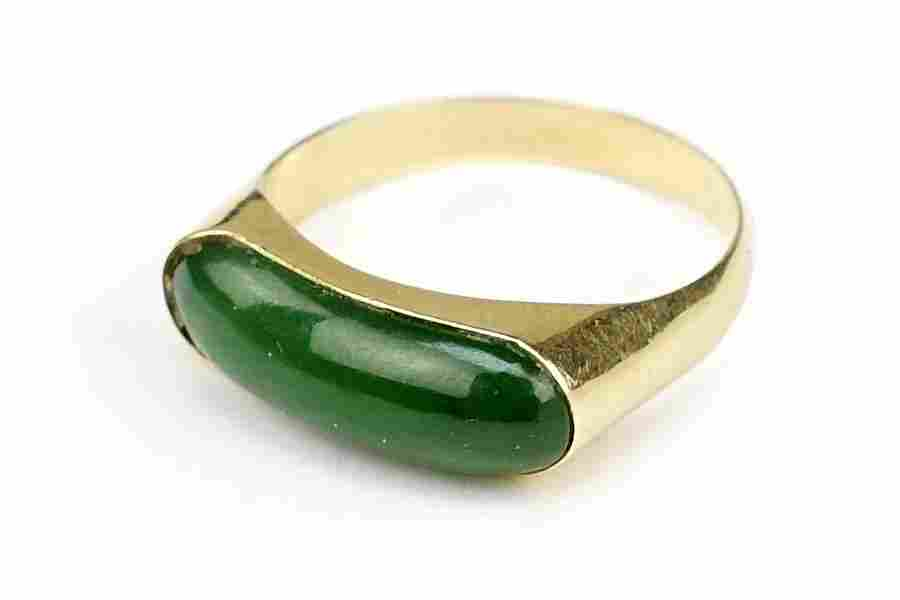 A Jade and 14 Karat Yellow Gold Ring.