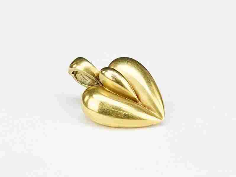 A Kieselstein Cord Heart Pendant.
