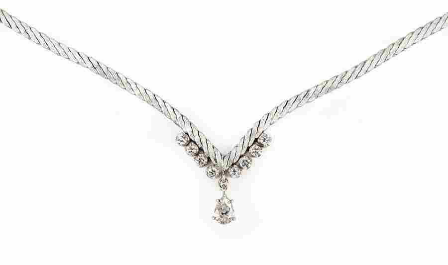 A Diamond and 18 Karat White Gold Necklace.