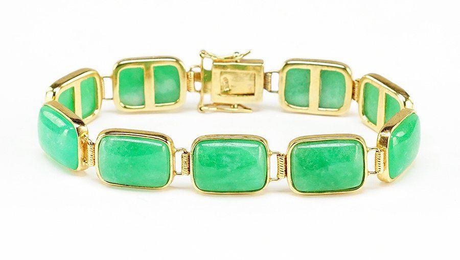 A Jade and 18 Karat Yellow Gold Bracelet.