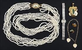 An 18 Karat Yellow Gold and Jade Pendant