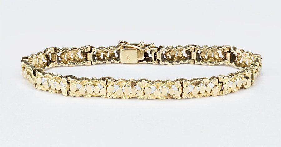 A 14 Karat Yellow Gold Bracelet.