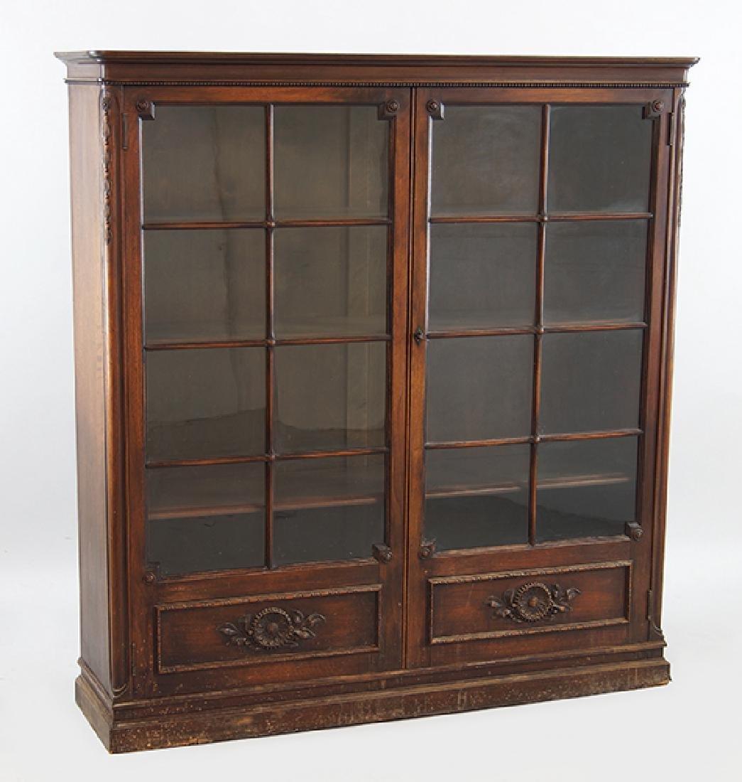 A Carved Mahogany Cabinet.