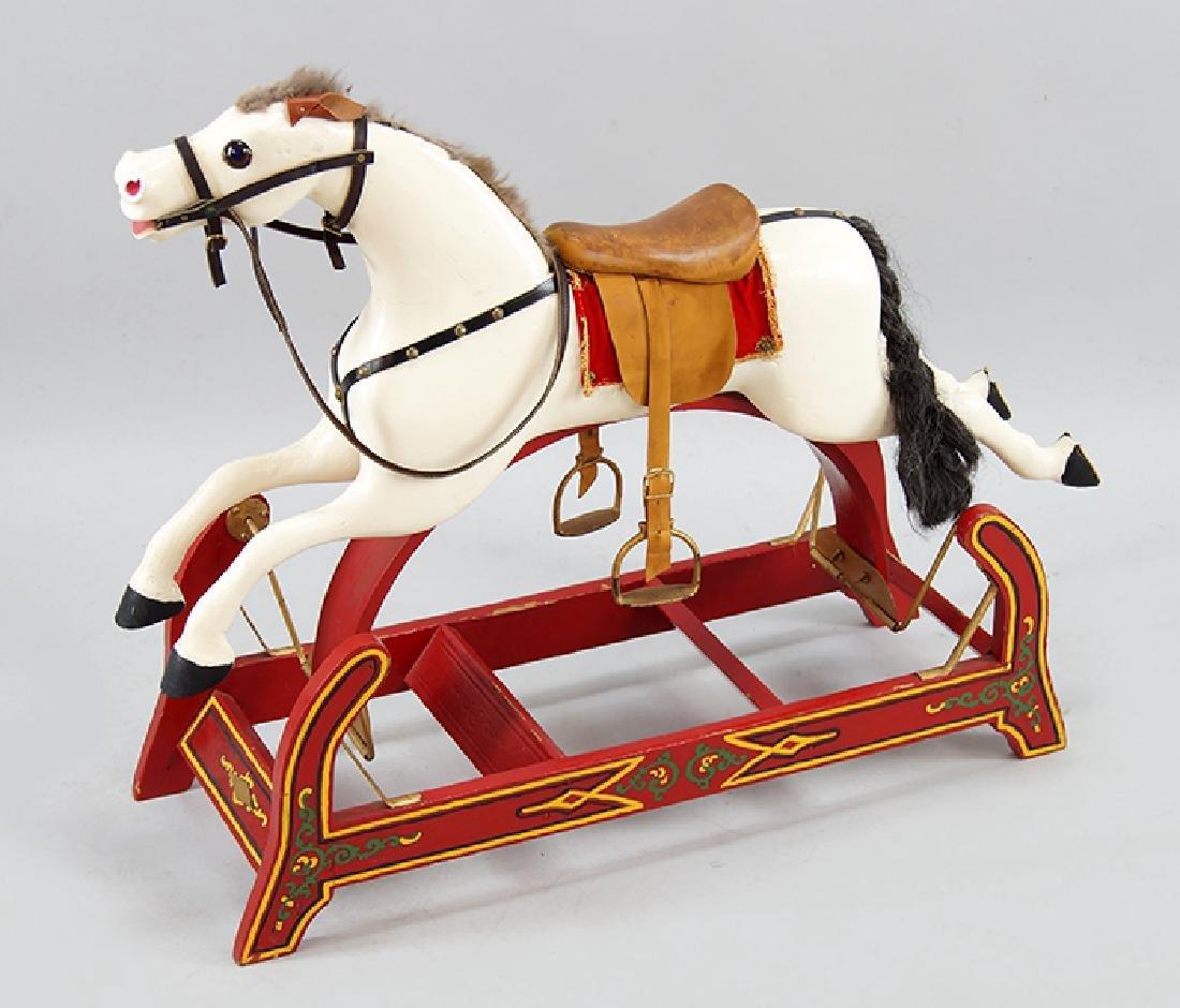 A Morton Converse Swinging Glider Rocking Horse.