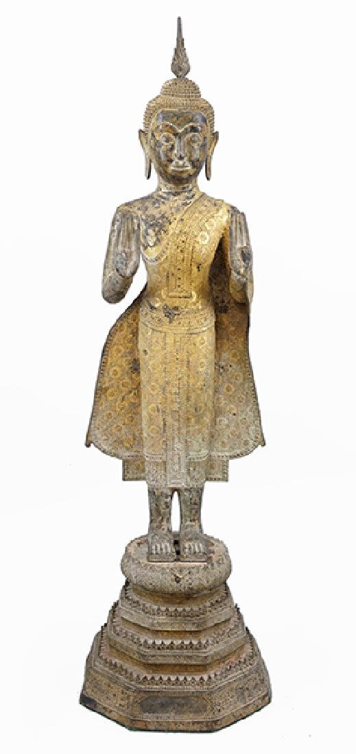 An Early 19th Century Thai Gilt Bronze Standing Buddha.