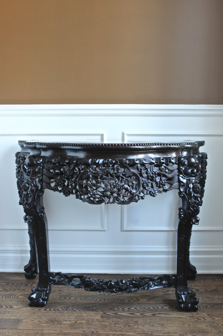 A CHINESE HANDCARVED HARDWOOD MARBLE TOP DEMILUNE TABLE