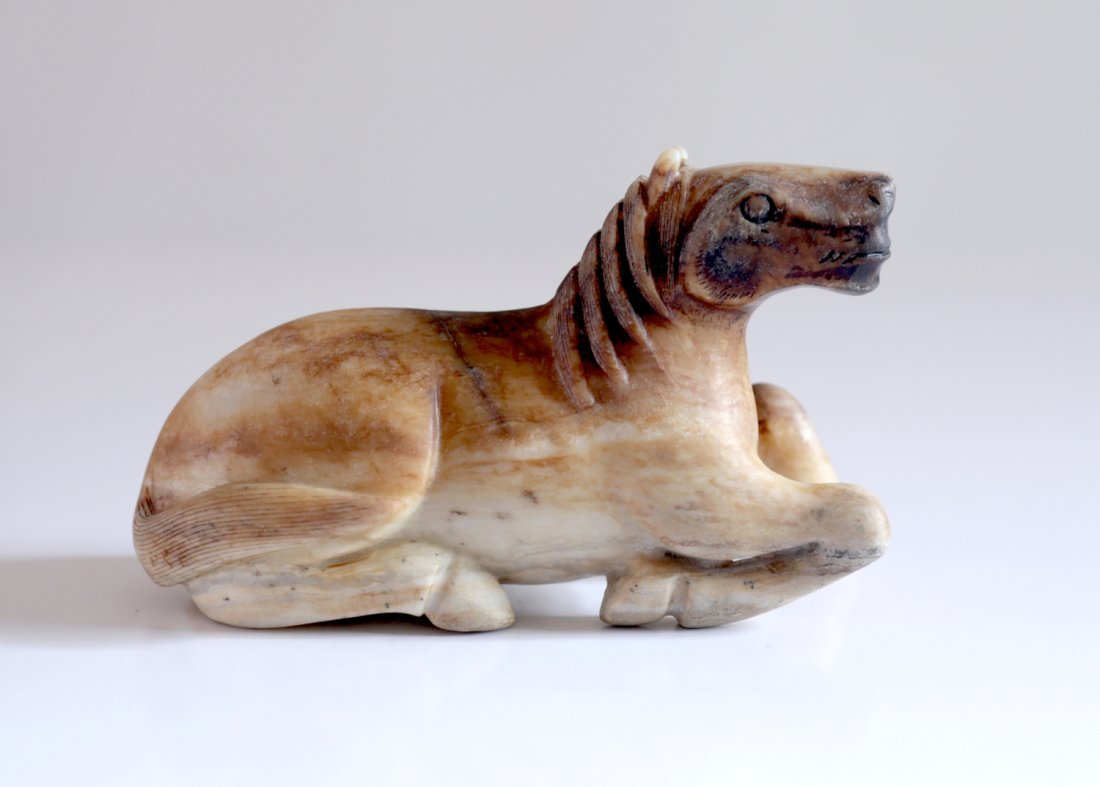 EX-FREEMANS: CHINESE BROWN & WHITE CALCIFIED JADE HORSE