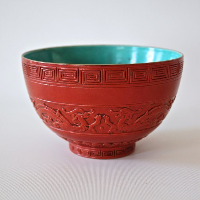 A CHINESE FAUX RED LACQUER PORCELAIN BOWL QIANLONG MARK