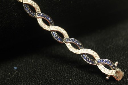 Fancy Sterling Silver Blue & White Sapphires Bracelet.