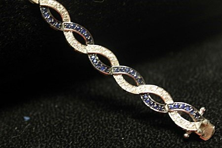 Fancy Sterling Silver Blue & White Sapphires Bracelet.