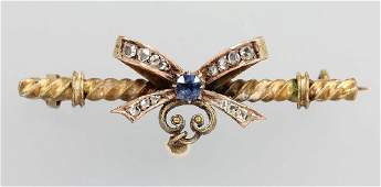 14 kt gold brooch with diamond roses and sapphire