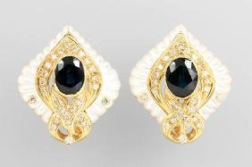 Pair of 18 kt gold earrings with mother of pearl,