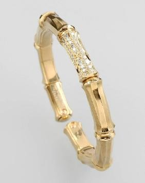 CARTIER 18 kt gold bangle with brilliants