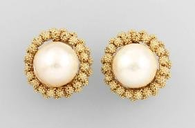 Pair of 14 kt gold earclips with mabepearls