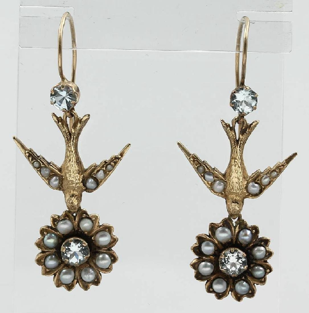 Pair of 9 kt gold earrings 'swallow' with pearl and