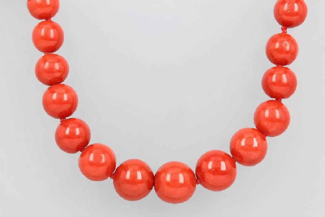 Necklace made of coral spheres