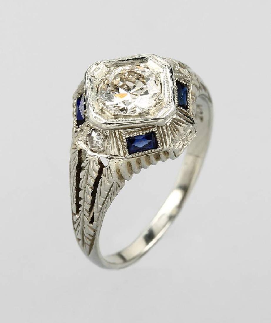 18 kt gold ring with diamond and sapphires, approx.