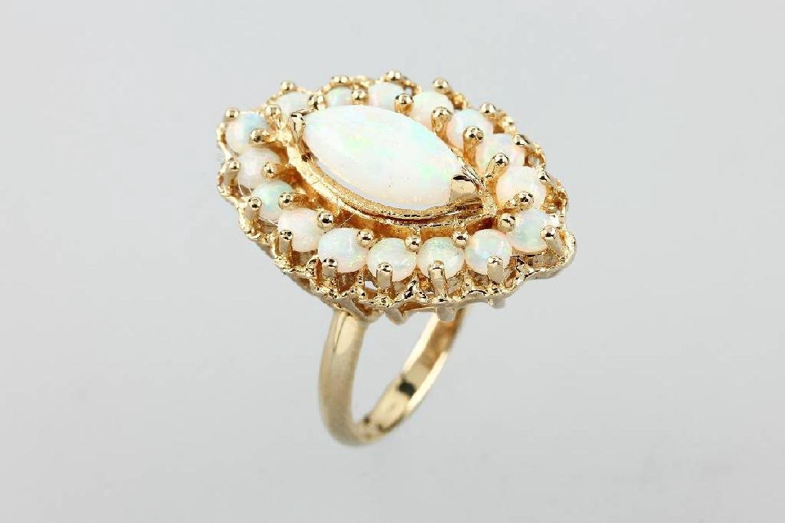 14 kt gold marquise ring with opals