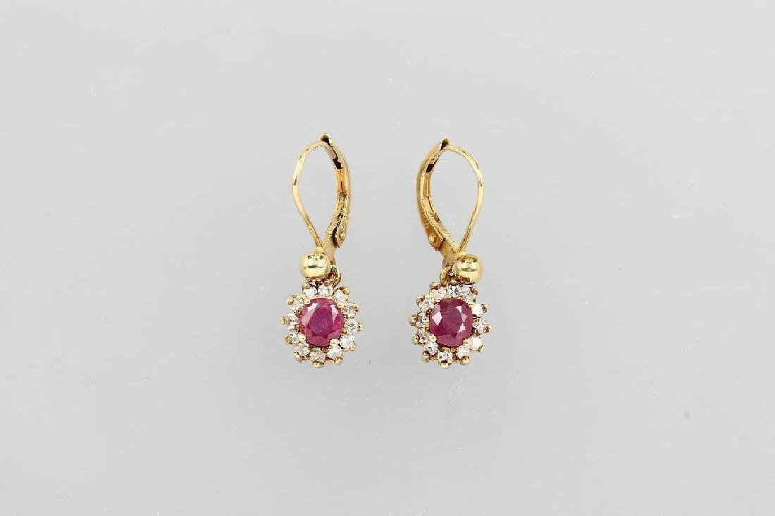 Pair of 14 kt gold earrings with rubies and diamonds