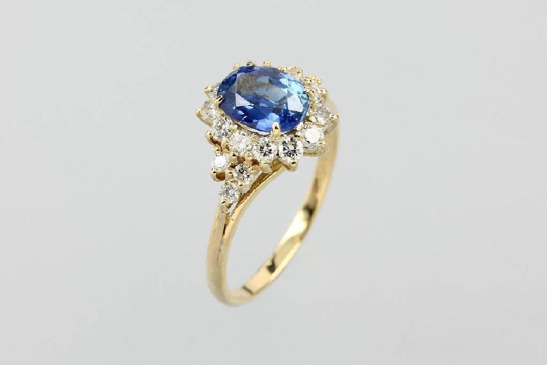18 kt gold blossom ring with sapphire and diamonds