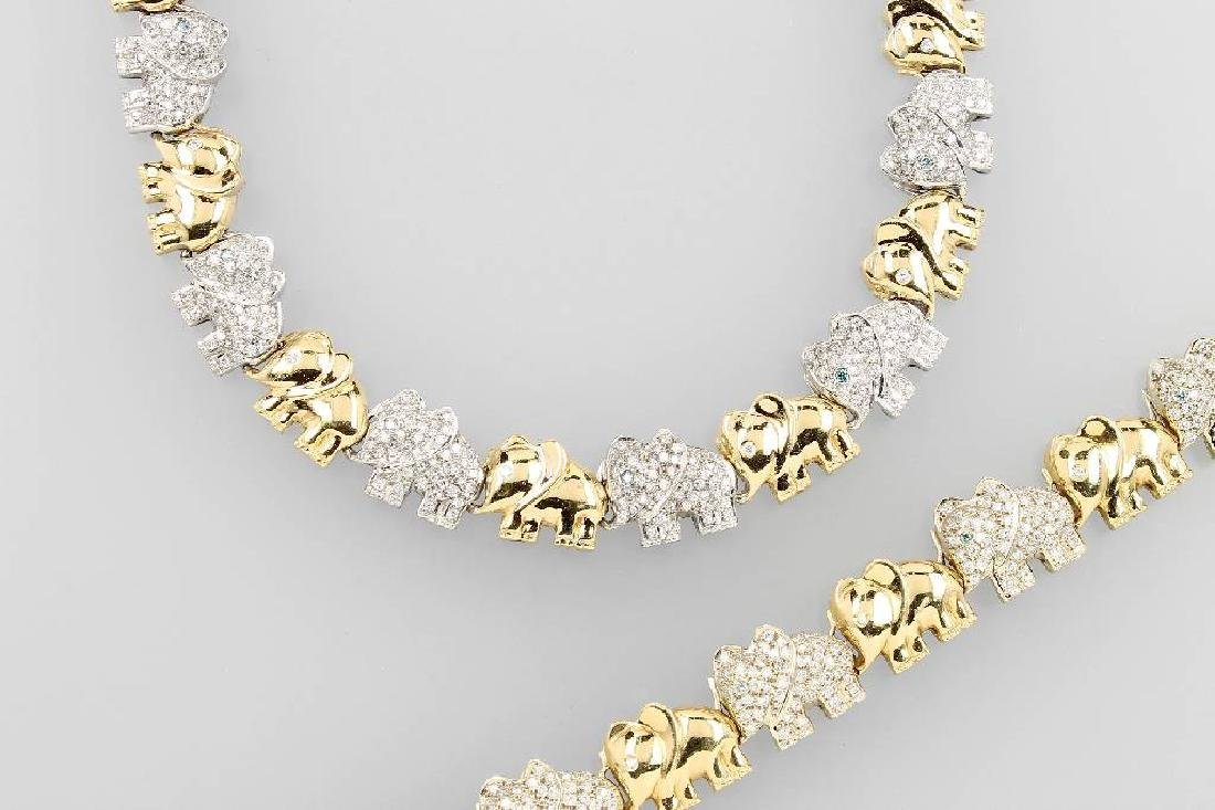 18 kt gold jewelry set with brilliants 'elephants'
