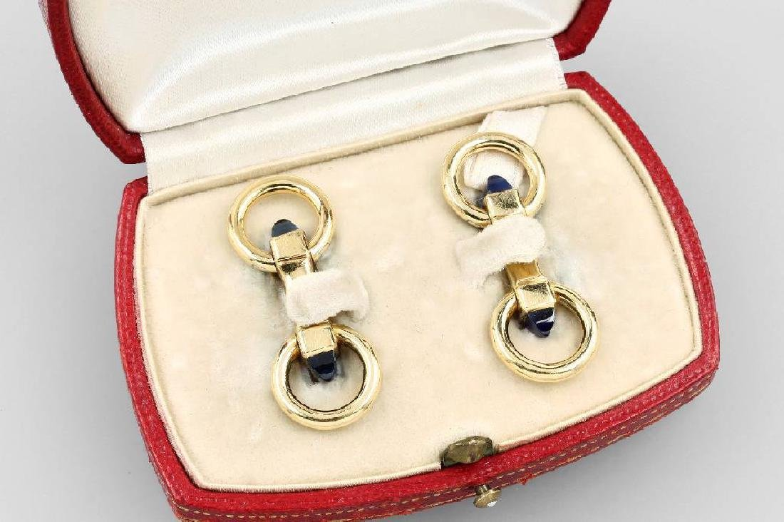 Pair of CARTIER cuff links with sapphires