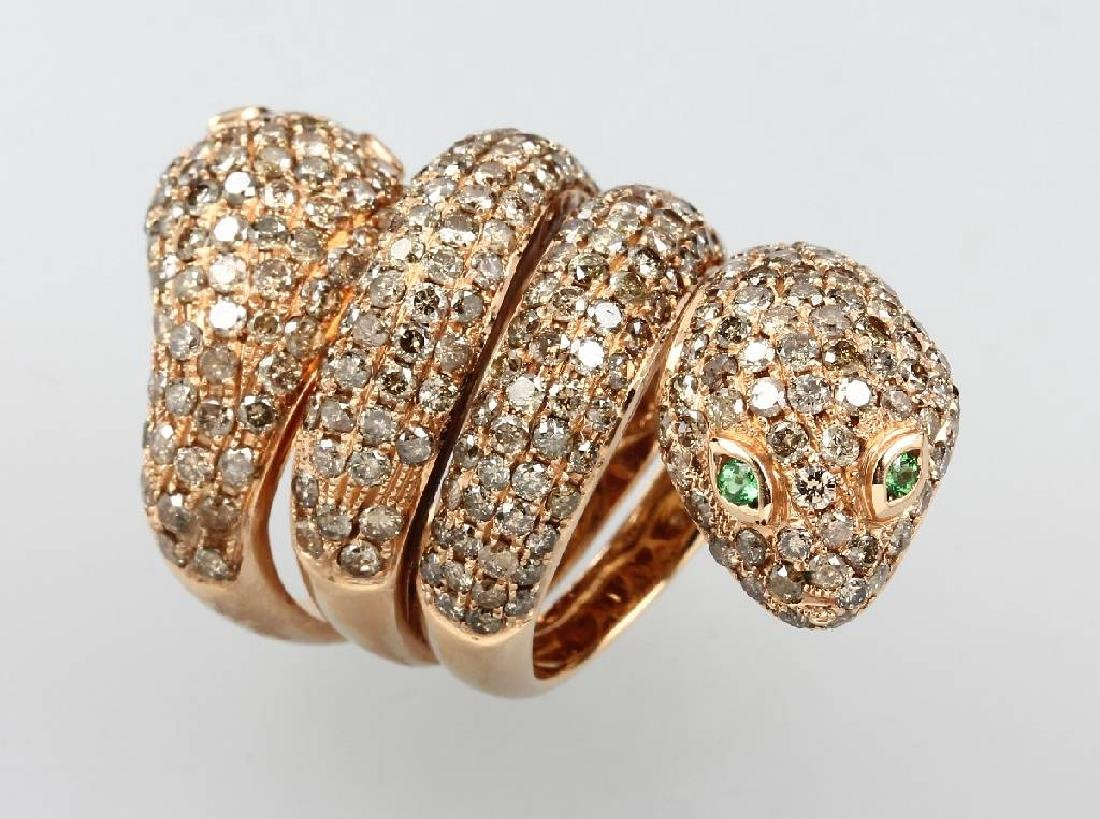18 kt gold snakering with emeralds and diamonds