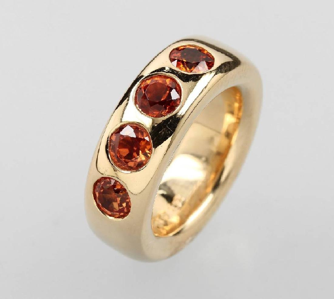 18 kt gold ring with orange coloured sapphires