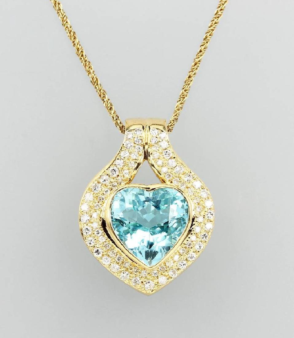 18 kt gold pendant with topaz and brilliants