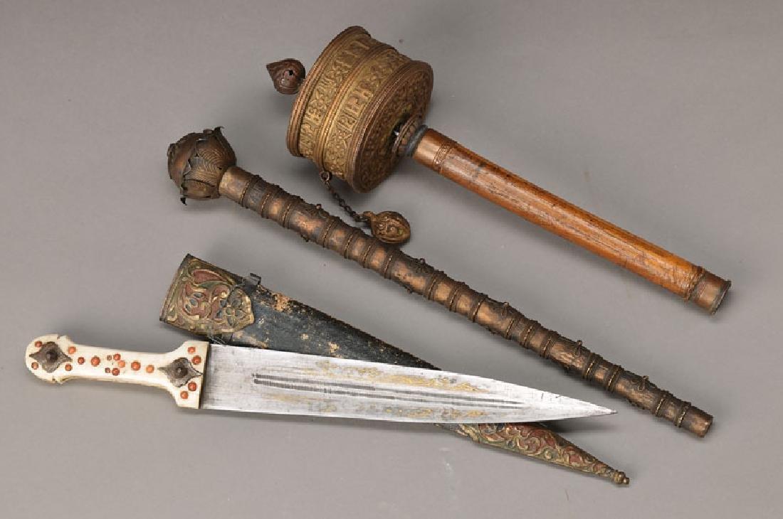 prayer wheel and scepter