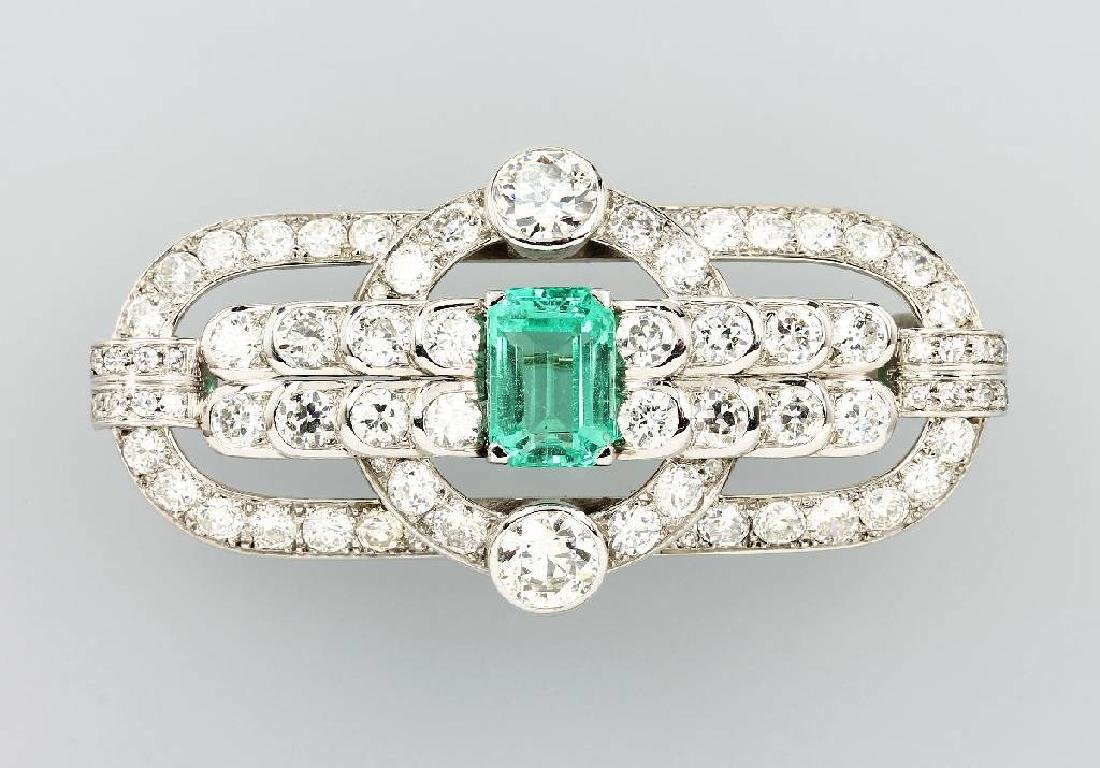 14 kt gold brooch with diamonds and emerald, approx.