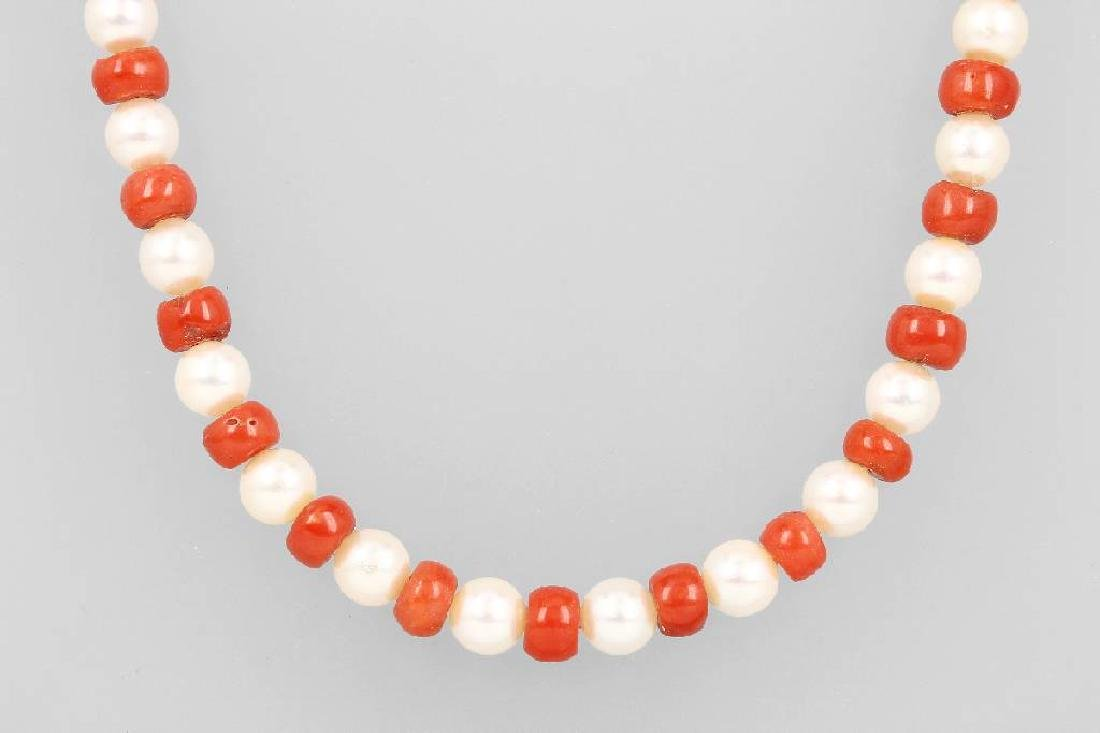 Necklace with cultured akoya pearls and corals