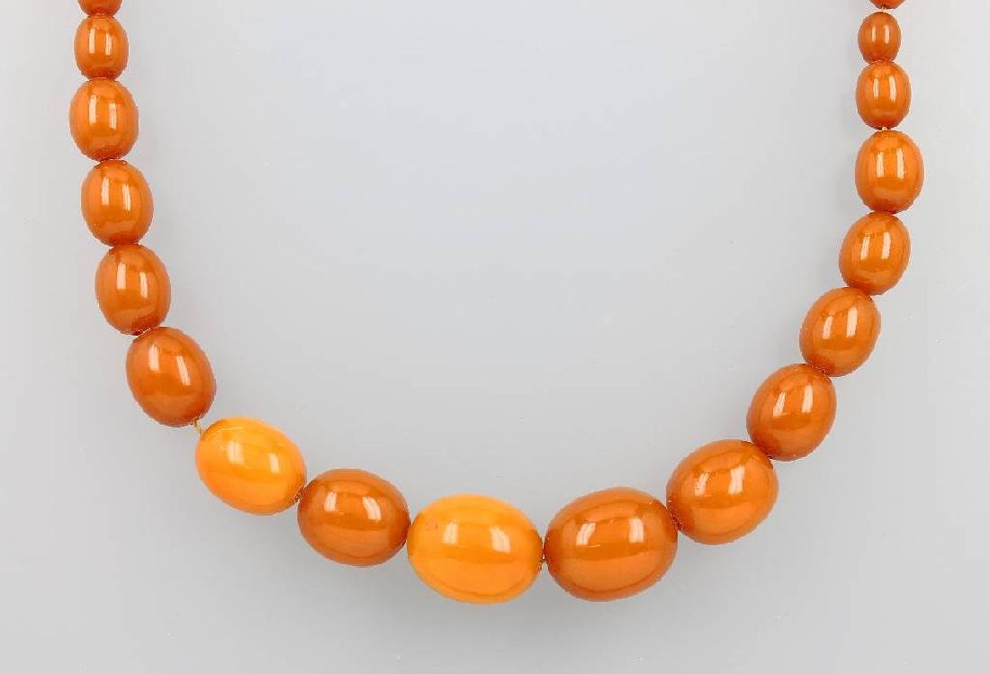 Necklace with amber, bevelled amber olives
