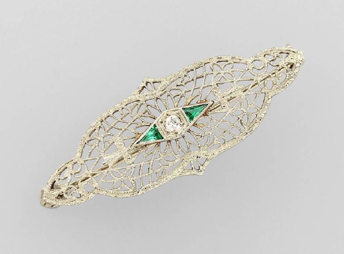 Brooch with diamond and emeralds, platinum